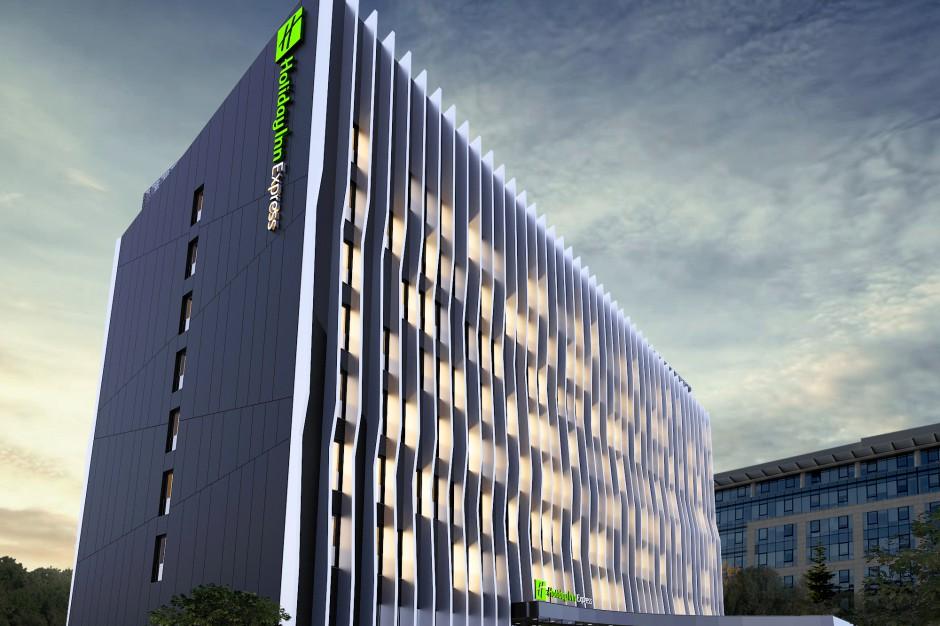 5th Avenue Holding ma grunt pod nowy hotel Holiday Inn Express
